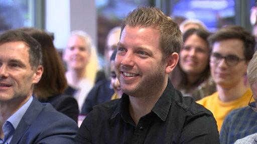 Florian Kohfeldt bei einer Podiumsdiskussion an der Uni Bremen
